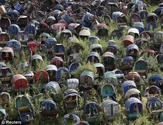 Someone needs to recycle these--Abandoned rickshaws sit on a hill in Mirpur, Dhaka, Bangladesh