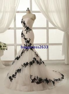https://www.etsy.com/listing/187384797/new-white-with-black-applique-wedding