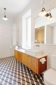 Looking for some ideas for a future bathroom makeover. Love this! Probably to classic for our 70s house though