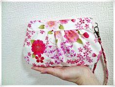 Pleated clutch wristlet gathered purse zip pouch 2 way Japanese kimono cotton chirimen sakura cherry blossom by KawaiiSakuraHandmade on Etsy https://www.etsy.com/listing/116970280/pleated-clutch-wristlet-gathered-purse
