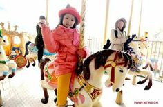 #CHINA Saturday, FEB. 1st. 2014 #CHINA_DAILY ~ Spring Festival celebration at Beijing temple fair: A young girl rides merry-go-round during a temple fair to celebrate the Spring Festival, or the Chinese Lunar New Year, in Beijing, capital of China, Jan 31, 2014. [Photo/Xinhua] [} http://www.chinadaily.com.cn/culture/2014-02/01/content_17267003.htm