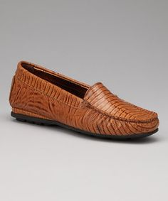 There's no loafing around in these perfectly constructed loafers. Supple Italian leather and custom comfort technology combine in a timeless silhouette to create a pair of shoes that can keep up with any modern lady's schedule.