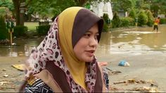 12/28/2014 - Malaysia struggling to help flood-hit citizens