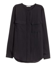 Long-sleeved blouse in chiffon with concealed buttons down the front, a yoke with a box pleat at the back and cuffs with a button.