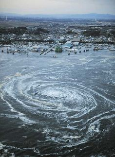 Japan earthquake causes vast whirlpool - incredible picture and video - mirror.co.uk