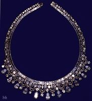KING FAISAL OF SAUDI ARABIA NECKLACE The necklace is a fringe design and is set with brilliant and baguette diamonds. Made by Harry Winston, King Faisal bought the necklace and presented it to HM on a state visit to the United Kingdom in 1967.