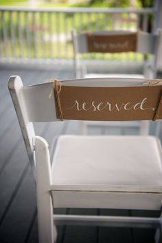 """Reserved"" seat signs for family tied with twine. I would do this instead of having ushers to seat guests at my wedding."