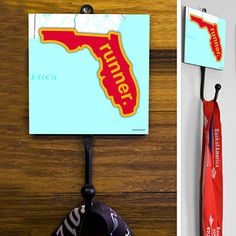 Florida State Runner (Red/Yellow) Medal Hook - This GoneForaRUN exclusive Wall Medal Display is made from hand-forged steel and features a customized printed tile.  Showcase one special medal, or stack multiple medals on the hook for easy access.
