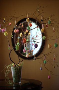 Beautiful egg tree!  All of the eggs were blown out and decorated.  I love the way they knotted the ribbon at the bottom. So cute!