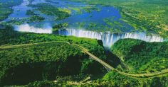 Victoria Falls, on the border between Zambia and Zimbabwe. Among the Seven Wonders from the Natural World along with a UNESCO World Hertiage Site. At its peak flow around June, a mile-wide chasm 100m lower is filled with the roar of water falling for a price of 3,000 tonnes per second.