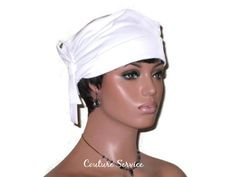 """White Lined Turban Hat, Handmade Side Looped by Couture Service This is a self-lined turban with side shirring, accented by an attached looped tie, and a softly rolled brim. Interfaced top.Medium weight Poly Lycra jersey.Wear at the eyebrows, or up high on the head.Size M for this turban is 23"""". The mannequin's head measures 22""""."""