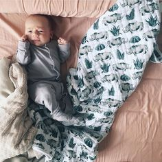 Evening snuggles! @livinglifewithcarter  shop Rhino Muslin Quilts at spearmintLOVE.com