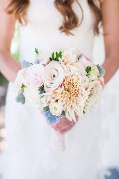 Wedding Bouquets :     Picture    Description  Prettiest mix of pastel colored dahlias, garden roses and ranunculus. Photography: Kate Webber Photography – katewebber.com  Read More: www.stylemepretty…
