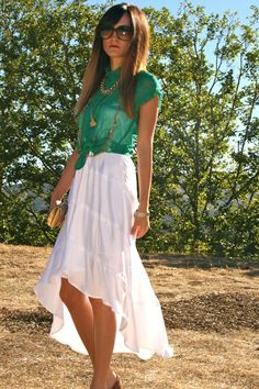 Wear a see-through button up shirt over a summer dress and tie in the front  Add a long chain to complete the look