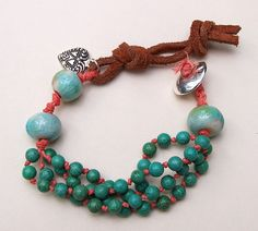 Erin Siegel -- Irish linen waxed cord and leather serve as the base for these turquoise and lamp work beads.  Very nice boho style.