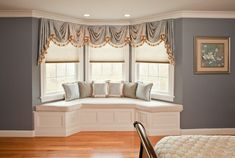 Window treatments for bay windows with window seat and gray wall paint colors