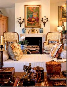 Charles Faudree ~ One of Faudree's last residences featured a French day bed that sat in front of the fireplace.The familiar sconces appear here as do the familiar bergeres in the damask.  A stunning collection of tortoise shell boxes sit atop the tea table.