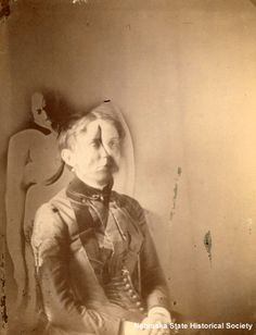 """Oddly, spirit photographers had a wide following even though """"ghost"""" images were relatively common in early photographs. Emulsions required long exposure times, and a moving vehicle or a walking person, moving too fast to be """"seen"""" by the emulsion, might briefly pause, allowing a semi-transparent image to be recorded on the plate, then move on without being """"seen"""" again."""