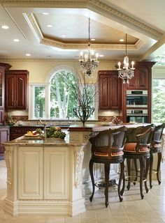 I like how the cabinets match the island counter & the island is cream with granite. LOVE the mix and match