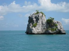 Thailand - gorgeous natural rock formations in a clear, blue sea.