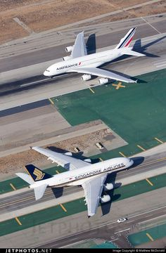 Air France Airbus A380 and Singapore Airlines Airbus A380-841 at Los Angeles Airport. Note how small the car is in comparison to the huge aircraft.
