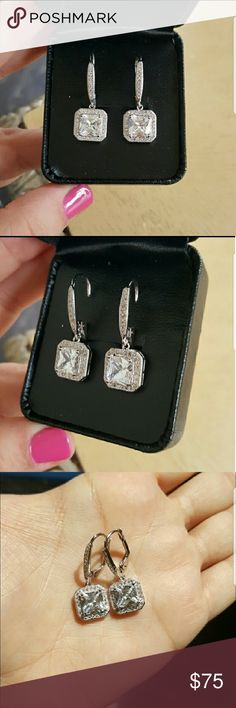 18k Swarovski Princess cut earrings Brand new never used, 18k gold plated Swarofski element crystals princess cut earrings comes with a nice box not the one in the picture ... please see pic 6&7 for more details Swarovski Jewelry Earrings