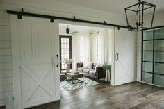 Love the idea of having black doors with a white trim while keeping the windows white trimmed