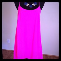 """Fushia New  Years dress by Dainty  Hooligan Never worn Fushia New  Years dress by Dainty  Hooligan Size: M,  Measurements are : 24."""" From under arm and 34."""" From shoulder,  necklace sold separately , I do bundle to save you money Dainty hooligan Dresses Mini"""