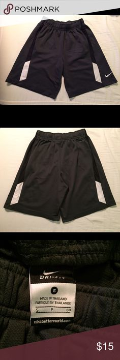 🏀NIKE Dri-Fit Basketball Shorts-Youth Small Nike Dri-Fit basketball shorts size Youth Small. The colors are dark gray, black and white. Features side pockets and an elastic waistband with a drawstring. The Nike Swoosh logo is on the outside left leg. The inseam is 8 inches. Excellent condition. Nike Bottoms Shorts