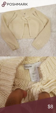 Cream 2T BabyGAP Cropped Sweater Item: Cropped Sweater  Condition: EUC  Size:2T   Welcome to My Poshmark where you will find gently used or new kids, women's and men's clothing.   All items are looked over before sending out.  If there is a missing part of the outfit or clothing item it will be put in the description and also pictured.  All items come from a pet free, and smoke free home. If you have any questions feel free message me. Sorry no trades.   Thank you and have a great day! GAP…