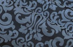 Crescendo Swirl Pattern Fabric in Blue is a light/dark blue dimensional scroll pattern in a synthetic blend. This versatile designer fabric works for upholstery, drapery, and bedding & pillows. Get it for only $30 per yard with FabricSeen's 67% discount.