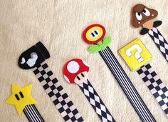 Nintendo Super Mario Bros Pacifier Clip - Set of 6 - Star Bullet Mushroom Flowerpower Goomba - Soothie Universal Baby Boys Shower Gift. $42.95, via Etsy.