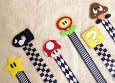Nintendo Super Mario Bros Pacifier Clip - Set of 6 - Star Bullet Mushroom Flowerpower Goomba - Soothie Universal Baby Boys Shower Gift. $35.95, via Etsy.