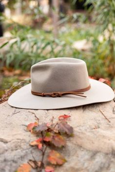 The Logan Panama Hat from Wyeth features a wider stiff flat brim with a knotted leather hat band. #hats #bohemianhat #hatsforwomen