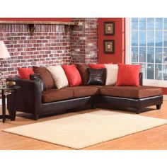 Coral, Cream, Brown And Brown Leather Accent Pillows Adorn A Brown Leather  Sectional With