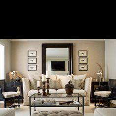 Leaning a large mirror behind your sofa is like adding another doorway into another (imaginary) room—and much cheaper than a renovation!  It completely opens up the space, and there's still room for art on both sides.