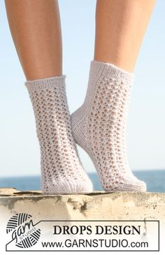 """Knitted socks in """"Alpaca"""" with lace pattern. ply, light steel blue, For a more hard wearing sock use Drops Fabel or Drops Delight, DOUBLE POINTED NEEDLES size sts x Lace Knitting, Knitting Socks, Knitting Patterns Free, Lace Socks, Crochet Slippers, Drops Design, Magazine Drops, Drops Patterns, Knit Shoes"""