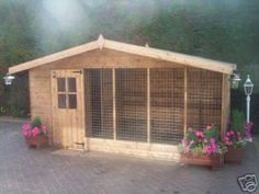 Now that's a dog kennel!! Could be one sweet chicken coop too with some modifications. More