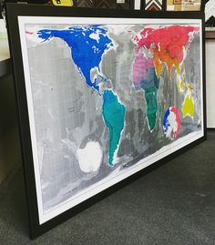 Massive 7 foot by 4 foot custom framed magnet world map! We can frame almost anything! #art #pictureframing #customframing #denver #colorado #mapframing