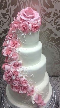 Pink Cascading Rose Wedding Cake I would choose two-toned orange and yellow roses.or the deep purple ones.LOVE this cake style! Extravagant Wedding Cakes, Elegant Wedding Cakes, Beautiful Wedding Cakes, Gorgeous Cakes, Wedding Cake Designs, Pretty Cakes, Cute Cakes, Amazing Cakes, Wedding Ideas