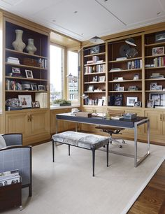 Detailed in a warm wood, the library millwork provides the backdrop for a Ralph Pucci desk. The Rue De Seine bench from Holly Hunt is upholstered in natural shearling by Keleen Leathers; the rotating four-arm Serge Mouille sconce is from Guéridon. Hudson Furniture, Office Furniture, Simple Desk, Interior Decorating, Interior Design, Interior Ideas, Eco Friendly House, Dining Room Chairs, Decoration