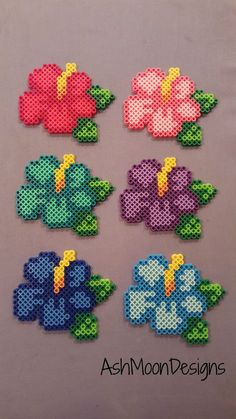 Perler Bead hama Hibiscus Flowers by AshMoonDesigns on Etsy Easy Perler Bead Patterns, Melty Bead Patterns, Perler Bead Templates, Diy Perler Beads, Perler Bead Art, Pearler Beads, Beading Patterns, Melty Beads Ideas, Diy Perler Bead Crafts