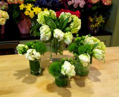 Celebrate Earth Day By Making An Arrangement In Recycled Containers I Used Parrot Tulips Hydrangea Hyperi Berries And Fuzzy Green Tricks Dianthus