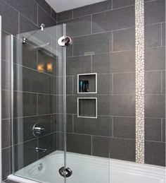 Dark gray tile is the way to go for a contemporary and unique shower space. The dark color prevents stains from showing which is another plus.