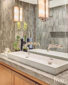 7. A Stylish Sink  In this modern gray master bath, the Wetstyle sink is from Davis & Warshow, as are the Horus faucets. The Tall Keeley pivoting sconces are from Circa Lighting.