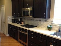 Kitchen cabinet re do. Rust-oleum cabinet transformation in Tudor ...