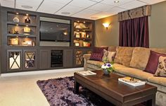 Basement, : Stunning Basement As Living Room Decoration With Furry Shinning Purple Rug Along With Rectangular Solid Wood Coffee Table And Brown Suede Long Coach