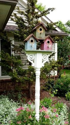 Sandra Hogan painted these birdhouses