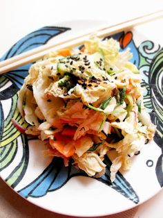 Cole Slaw  You'll need:  1 cup water  1/4 cup sugar  Salt  1 cup + 1 tbsp. rice vinegar  2 tbsp. soy sauce  3 tbsp. miso paste  3 tsp. siracha  1/2 lb. silken or soft tofu  2 large carrots  1/2 red onion  5 cups Napa cabbage  4 small Persian cucumbers  1 tbsp. black sesame seeds  1 green jalapeno  1 cup fresh mint leaves  1 cup fresh cilantro leaves  1 cup fresh Thai basil leaves