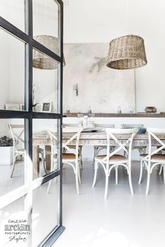 black iron doors and relaxed interior Villa Interior, Estilo Interior, Interior Styling, Interior Architecture, Wicker Dining Chairs, Dining Room Lighting, Interior Design Inspiration, Living Spaces, House Design